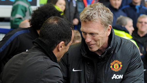 Manchester United manager David Moyes, right, was on the losing side on his return to Goodison Park