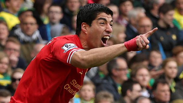 Liverpool striker Luis Suarez celebrated scoring his 30th goal of the season in Sunday's victory at Norwich