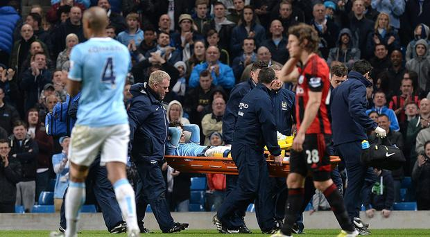 David Silva was carried off on a stretcher at the Etihad