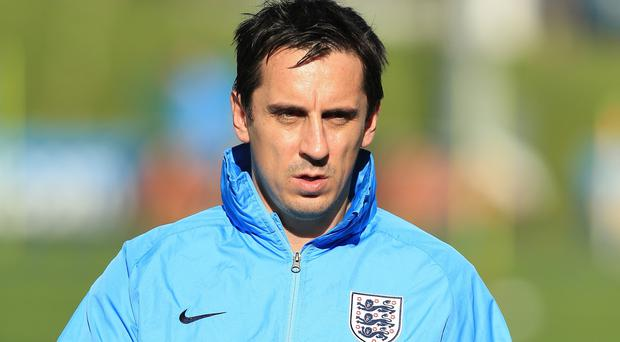 Gary Neville is the ideal man to succeed Roy Hodgson says former Team-mate Michael Owen