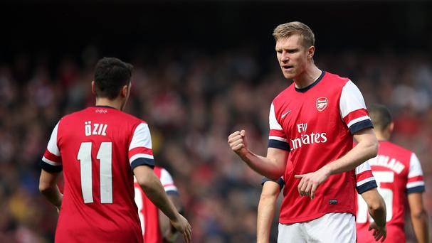 Per Mertesacker (right) believes Mesut Ozil can come back stronger next season.