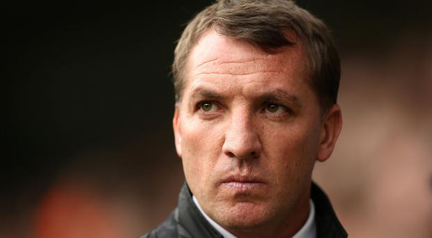 Liverpool manager Brendan Rodgers, pictured, claims Fenway Sports Group, owners of the club, are delighted with the progress made at Anfield