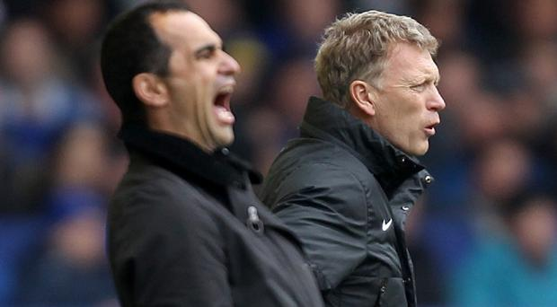 Everton manager Roberto Martinez, left, thinks David Moyes, right, will bounce back after leaving Manchester United