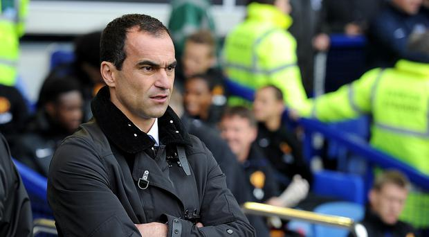 Everton manager Roberto Martinez is confident his side will secure Champions League football next season despite Arsenal holding a slender advantage.