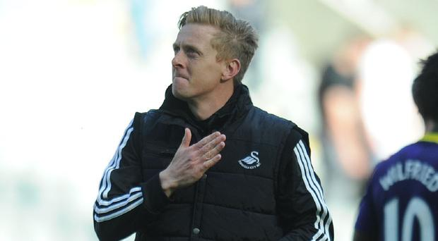 Swansea manager Garry Monk, pictured, is not thinking of his own future until the Welsh side have secured their top flight future