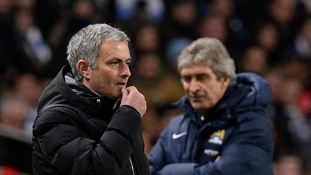 Manchester City manager Manuel Pellegrini, right, insists he is unconcerned about Chelsea boss Jose Mourinho, left, fielding a weakened team against Liverpool.