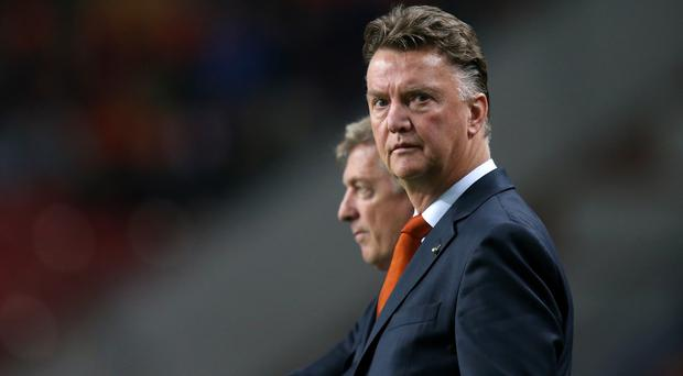 Bryan Robson believes Louis van Gaal should keep Ryan Giggs within a coaching ticket if he is appointed United manager.