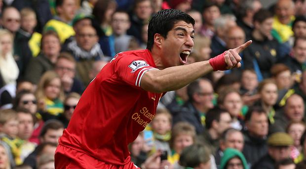 Ronnie Whelan expects Luis Suarez to remain at Anfield for next season