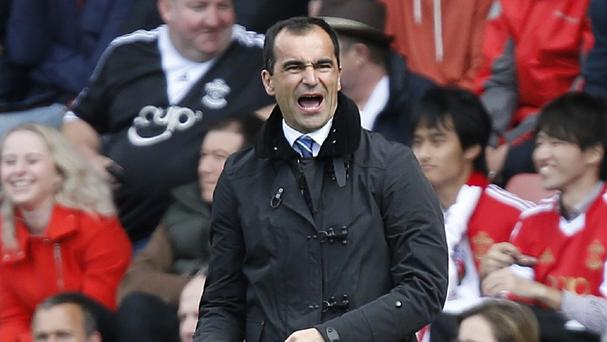 Roberto Martinez has not given up hope of leading Everton into the Champions League