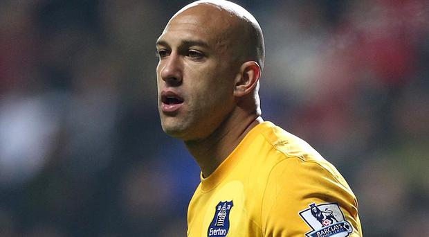 Tim Howard expects Everton to raise their game against Manchester City