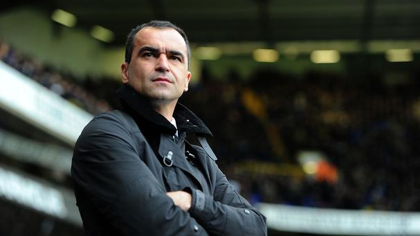 Manager Roberto Martinez insists his side have too much integrity to just make up the numbers against Manchester City - even if that means helping neighbours Liverpool's title chances