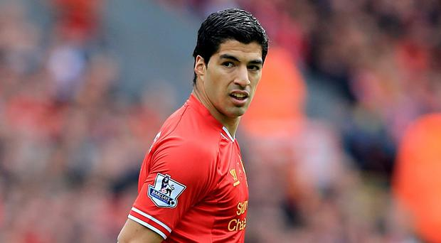 Liverpool forward Luis Suarez has been voted the 2014 Footballer of the Year by the Football Writers' Association.