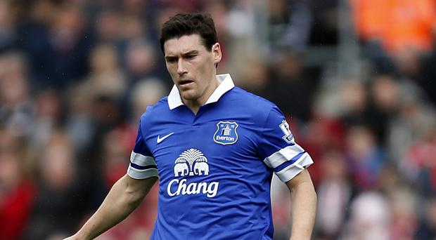 Everton manager Roberto Martinez believes loan players such as Gareth Barry, pictured, should be able to play against their parent clubs in domestic competitions