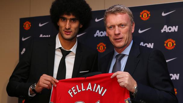 Marouane Fellaini, left, was sad to see David Moyes leave Manchester United