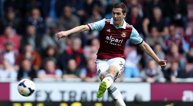West Ham United's Stewart Downing scores his sides second goal during the Barclays Premier League match at Upton Park, London.