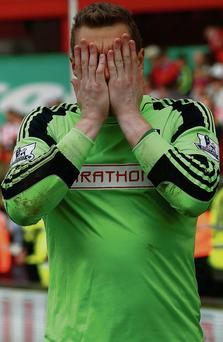 Goalkeeper David Stockdale reacts to the defeat that confirmed Fulham's relegation