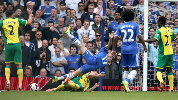Chelsea's Eden Hazard (centre) goes down in the box under a challenge from Norwich's Ryan Bennett but no penalty is awarded