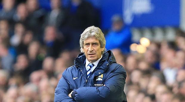 Manchester City manager Manuel Pellegrini knows his side still have a job to do to clinch the title