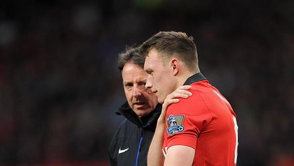 Phil Jones, right, has been taken to hospital with a shoulder injury