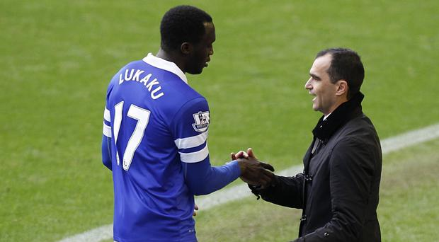 Roberto Martinez, right, is willing to wait to land his man on a permanent deal