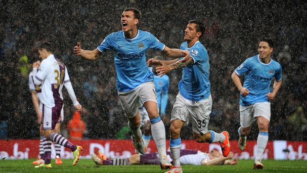 Edin Dzeko, centre, celebrates his opening goal against Aston Villa