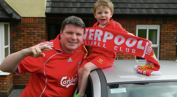 Graham Clifford sets off for Liverpool, with son Aodhan waving him off