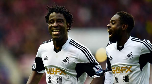 Swansea's Wilfried Bony, left, scored his side's third goal