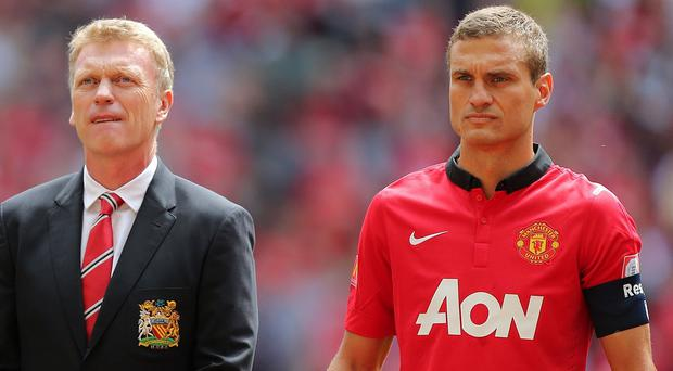 Nemanja Vidic, right, will not blame David Moyes for Manchester United's 'loss of belief'