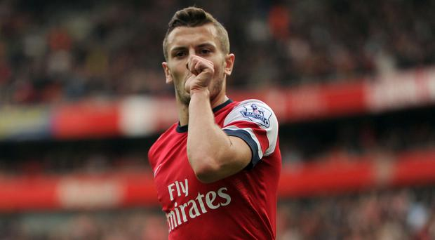 Jack Wilshere, pictured, said he was taken aback by Paul Scholes' comments