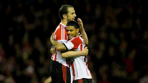 John O'Shea, left, helped Sunderland clinch safety against the odds