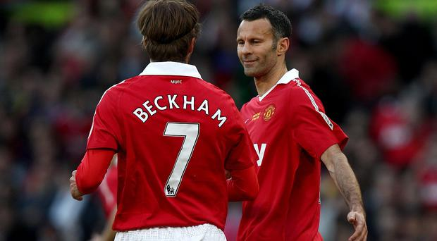 David Beckham is delighted Ryan Giggs, right, has been installed as Manchester United's assistant manager