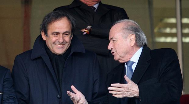 Michel Platin and outgoing FIFA president Sepp Blatter