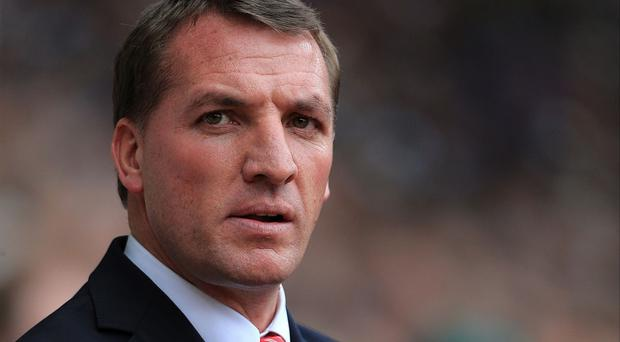 Liverpool manager Brendan Rodgers has been rewarded for his contribution to football