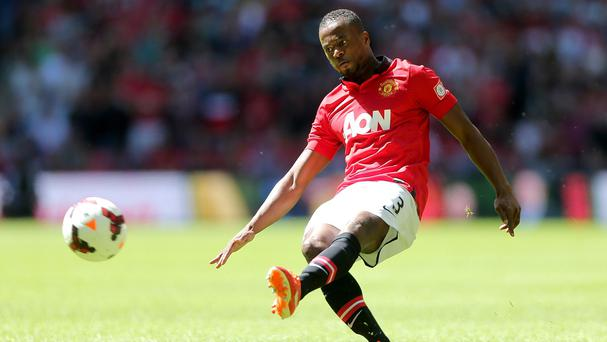 Patrice Evra is staying at Old Trafford