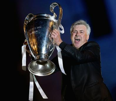 Carlo Ancelotti lifts the European Cup during Real Madrid's celebrations. GETTY