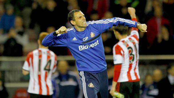 Gus Poyet has been rewarded for keeping Sunderland in the Premier League