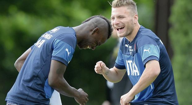 Ciro Immobile and Mario Balotelli share a joke during an Italian training session in Florence this week