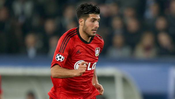 Liverpool have made Bayer Leverkusen midfielder Emre Can their second signing of the summer