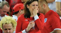 An England fan reacts to their defeat to Italy.