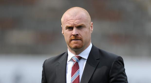 Burnley manager Sean Dyche has been rewarded with a new contract after guiding the club back into the Premier League