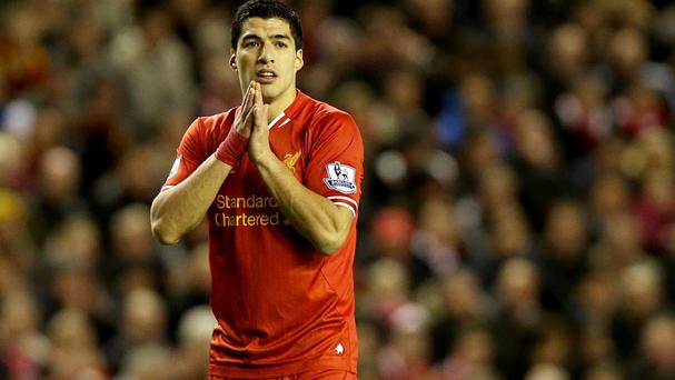 Liverpool will reflect on the full implications of Luis Suarez's four-month ban from all footballing activities over the next few days