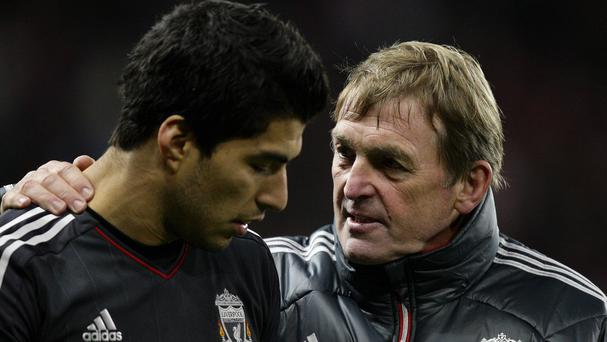 Kenny Dalglish, right, thinks Liverpool will stand by Luis Suarez, left