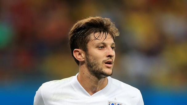 England and Southampton midfielder Adam Lallana has completed his move to Liverpool
