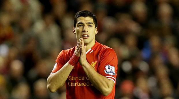 Luis Suarez is currently banned from football for four months