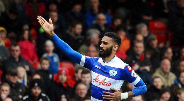 Armand Traore, pictured, follows Clint Hill and Alejandro Faurlin in remaining at Loftus Road