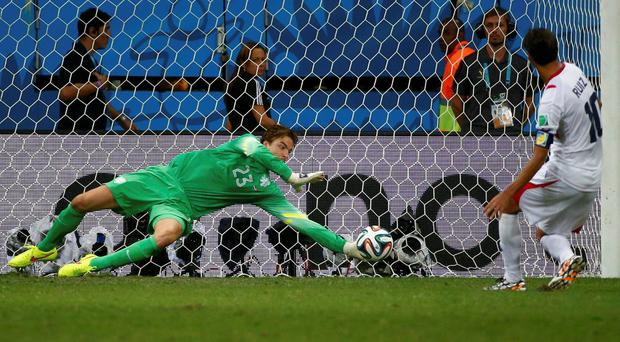 Goalkeeper Tim Krul saves Bryan Ruiz' penalty during the 2014 World Cup quarter-final between the Netherlands and Costa Rica at the Fonte Nova arena in Salvador. Photo credit: REUTERS/Michael Dalder
