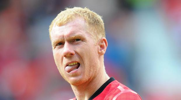 Former Manchester United star Paul Scholes is looking forward to Louis van Gaal's arrival as manager