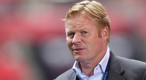 New Saints boss Ronald Koeman, pictured, is keen to keep hold of Dejan Lovren