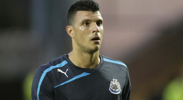 Haris Vuckic has apologised for posting a selfie on his way to New Zealand