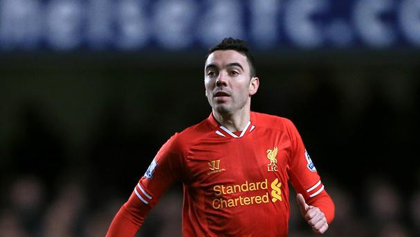 Sevilla have completed the formalities of their loan deal for Liverpool striker Iago Aspas